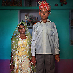 Maya, 8, and Kishore, 13, pose for a wedding photo inside their new home the day after the Hindu holy day of Akshaya Tritiya, or Akha Teej, in Rajasthan, India on April 29, 2009.