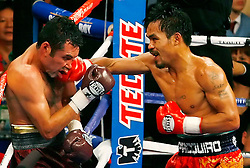 December 6, 2008: Oscar De La Hoya (Maroon) takes a right hand from Manny Pacquiao (Orange) during their 12 round welterweight bout at the MGM Grand Garden Arena in Las Vegas, NV.  No Usage/Sales Permitted PHOTO: Ed Mulholland/HBO