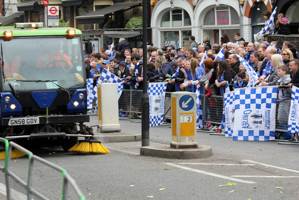 Chelsea supporters celebrate the 2012 Champions League victory on the parade through Parsons Green, May 20th 2012. A street cleaning van sweeps up the celery that is traditionally thrown by Chelsea supporters.