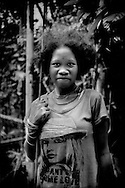 Portrait of young Batek Negrito woman in the rainforest on her way to going fishing, an important source of protein for the Batek.  Near Kuala Koh, Kelantan, Malaysia.