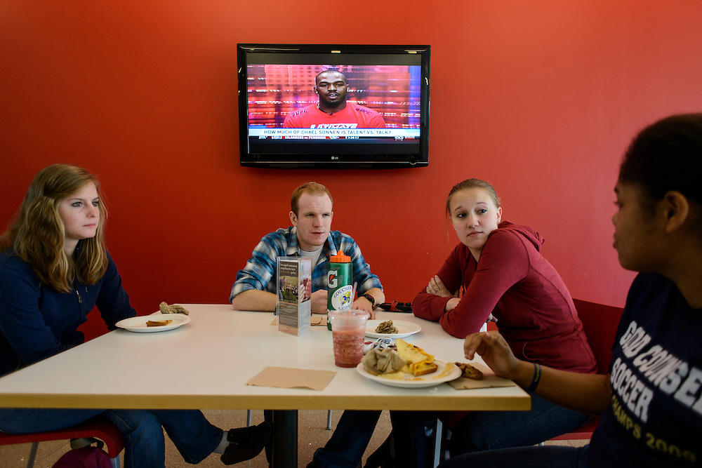 Photo by Matt Roth..During a break in between classes, Goucher College juniors (L-R) Shea Staab, from Fallston, Md., Brendon Blackford, from from Long Island, N.J., and Victoria Rain, from Ellicott City, Md., and freshman Lexi Rudolph, from Kensington, Md., catch up inside the Alice's Restaurant, a small cafe area inside Goucher College's library known as the Athenaeum in Towson, Maryland on Tuesday, January 29, 2013. Alice's Restaurant is a social hotspot inside the Athenaeum.