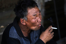 A picture made available on 05 July 2012 of a Mongolian miner taking a smoking break at a coal mine in the mining town of Nalaikh in Mongolia, 02 July 2012. Once a thriving mining town, Nalaikh is one of first and oldest mining site in Mongolia but has seen a decline in its fortune as mining disasters and accidents plague the site. With little government oversight, only a handful of small companies and informal miners work on the site with scant regard to safety standards. Mongolia is rich in a variety of natural resources including forests, coal, iron ore, gold and copper. Expansion of the mining industry has turned the sector into the most important income source and led to an economic growth rate last year of around 17 per cent. The majority of raw materials are exported to China. Seeking to to reduce the dependency on China for exports and Russian imports, Mongolia has embarked on a policy of closer economic ties with other countries such as Germany, Canada and the United States. Despite impressive growth rates, about one-third of the population lives below the poverty line while unemployment and inflation are high.