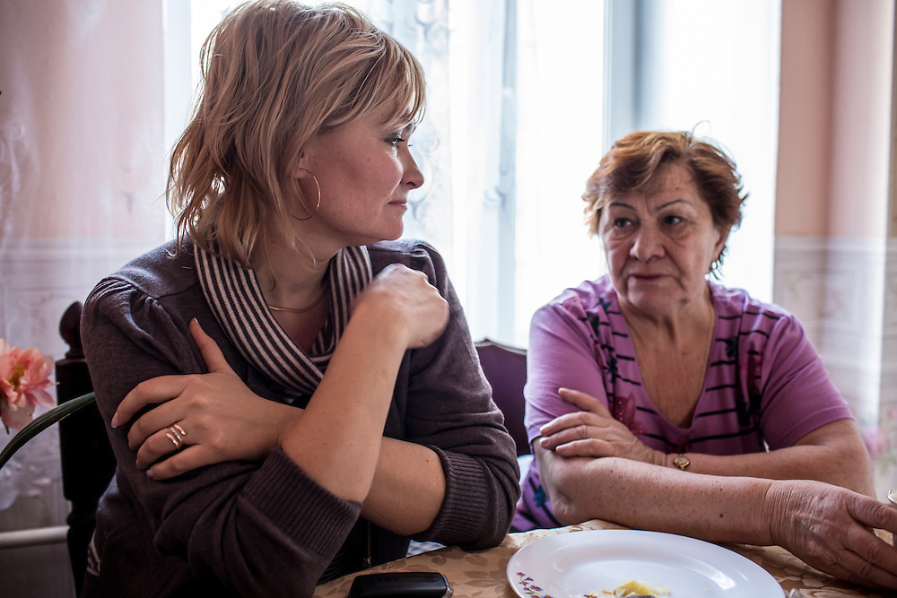 Inessa Rozova, left, and Nina Rozova, Alexander Panin's mother and grandmother, respectively, talk in Nina's apartment, where Panin was mostly raised, on Tuesday, February 25, 2014 in Tver, Russia. Panin, a Russian citizen who was arrested in the Dominican Republic in June 2013, is set to be charged by federal authorities in the US with being part of a gang which robbed bank accounts via the Internet. Photo by Brendan Hoffman, Freelance
