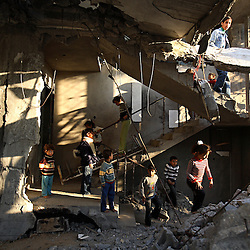 Children from the Abu Amsha family play around the crumbling stairwell of their home, which was destroyed by an Israeli airstrike.  Beit Hanoun, Gaza Strip, Palestinian Territories, Nov. 14, 2006.