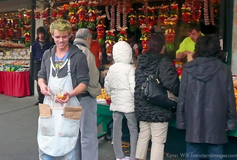 USA, Washington, Seattle. Vendor readies sliced apples to sample at Pike Place Market.
