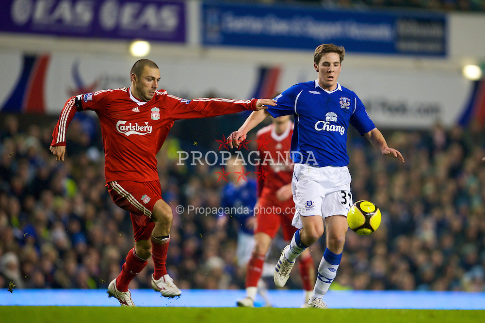 LIVERPOOL, ENGLAND - Wednesday, February 4, 2009: Liverpool's Andrea Dossena and Everton's Dan Gosling during the FA Cup 4th Round Replay match at Goodison Park. (Mandatory credit: David Rawcliffe/Propaganda)