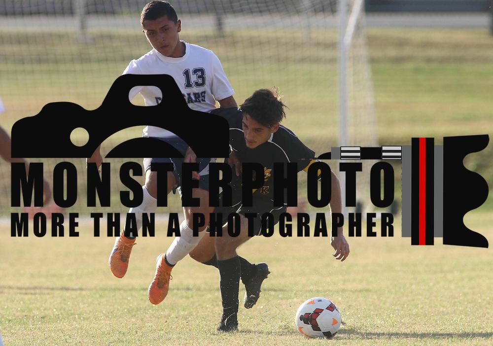 Delcastle Michael Delgado (13) battles Newark midfielder Jacob Coale (14) for the ball during a regular season soccer match between Newark and Delcastle Thursday, Oct. 22, 2015 at Delcastle in Wilmington.