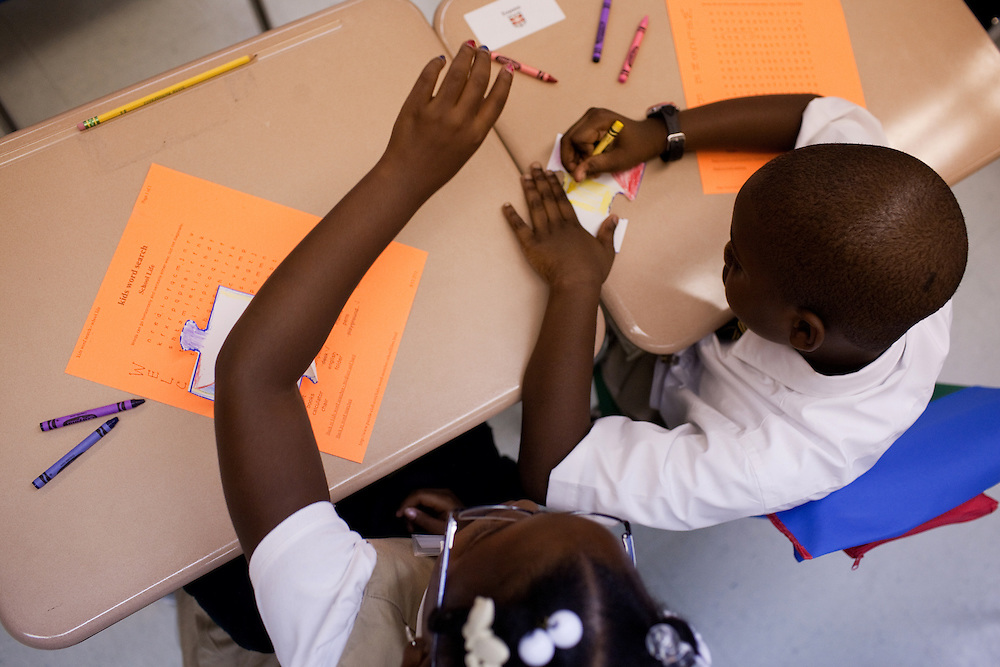 Third-grade students Zhynir, left, and Evyonn, right, work on an art project on the first day of class at Brownsville Elementary School in Brooklyn, NY on August 15, 2011.