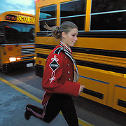 Freshman band member Brooke Damstra rushed to her bus, as the MOC-Floyd Valley band prepared to leave for their first field competion of the year at Southwest State University in Marshall, Mn.  The band had been rehearing at a local high school.  Damstra missed the rehearsal because she was playing in a volleyball game back in Iowa, but made it just in time for the band competition.
