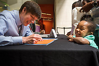 A children's author and a young fan at the Boston Book Festival.