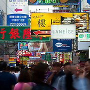 CHINA (Hong Kong). 2009. People walking under the advertisements in a street of Mong Kok.