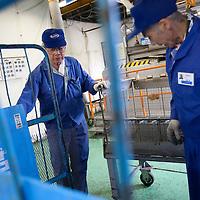 Hisao Kitawaki (on left of pic, 73 years old, in 8th year of working for Kato company) is an elderly worker at Kato (a light industry company) in Nakatsugawa, Japan, Monday 21st June 2010. Kato company has a workforce of 100 people, 50% of whom are 60 years of age or older. The elderly work force earn JPN ¥800-1,000 per hour, but receive no annual bonus or pay rise.