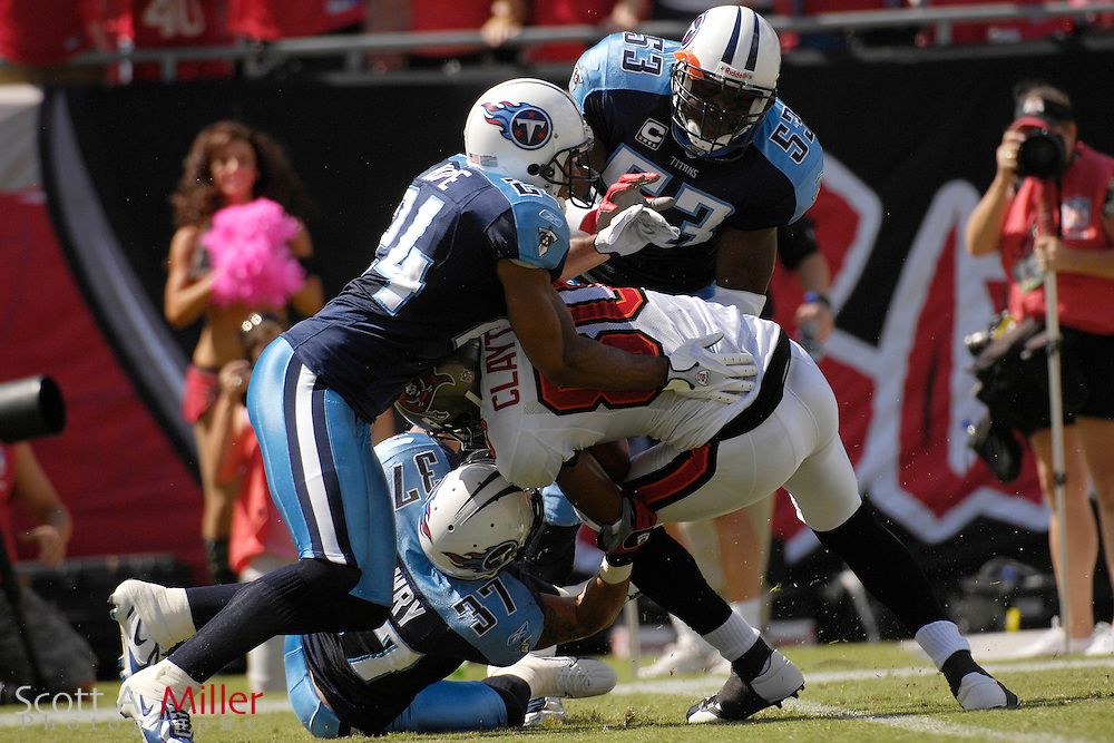 Oct. 14, 2007; Tampa, FL, USA; Tampa Bay Buccaneers receiver (80) Michael Clayton is tackled by Tennessee Titans defender (24) Chris Hope, defender (37) Calvin Lowry and defender (53) Keith Bullock in the first half at Raymond James Stadium. ...©2007 Scott A. Miller