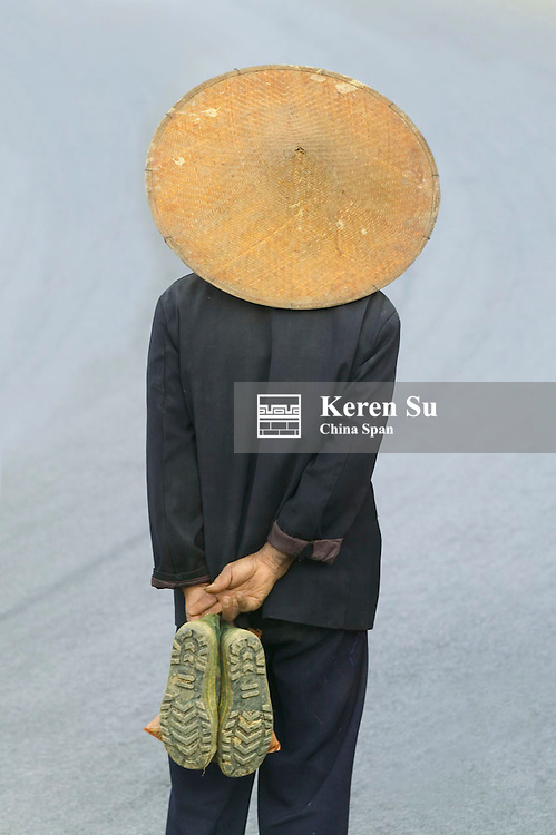 Farmer wearing bamboo hat backview, Yuanyang, Yunnan Province, China