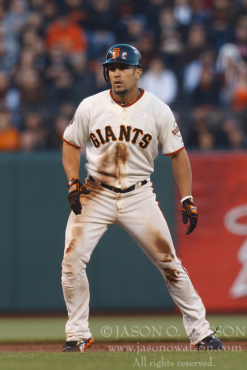August 29, 2011; San Francisco, CA, USA;  San Francisco Giants center fielder Andres Torres (56) leads off second base against the Chicago Cubs during the first inning at AT&T Park. Chicago defeated San Francisco 7-0.