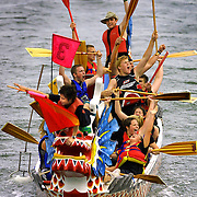 The Water Walkers from Cleveland High School are jubilant with their first place division finish in the finals of the dragon boat races during Rose Festival events.