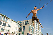 A new kind of sports has developed at Santa Monica Beach. After the city of Los Angeles built a structure with ten rings hanging from metal chains at a distance of about 2 yards, young athletes started using it and turned it into an art form. They call themselves 'ring flyers'. A community grew around the sport and websites sprung up to connect its and promote weekend gatherings involving the 'traveling rings', as the structure is called...©Stefan Falke / laif