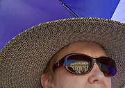 St. Peter's Basilica is reflected in a pilgrim's sunglasses. (Sam Lucero photo)