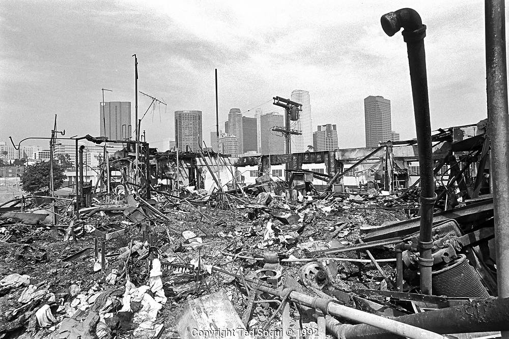 The skyline of downtown Los Angeles is seen in the background of a burned down apartment on Olympic Blvd. in the Pico/Union area of Los Angeles.<br /> Olympic Blvd. at Blaine Street.<br /> <br /> 25 before and after LA92 photo project.