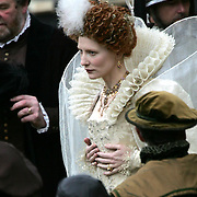 .Cate Blanchett in a stunning white gown plays Elizabeth I in a lavish new film being shot on location at Cambridge University...The film makers chose St John's College to shoot the famous scene where Sir Walter Raleigh (played by Clive Owen) lays his cloak over a puddle for the Queen to walk on..The Golden Age charts the latter half of the Elizabethan reign and also stars Geoffrey Rush ..See Mason's copy catchlined Elizabeth