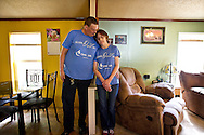 NORTH FREEDOM — October 6, 2014: SaDonna Oakley, right, stands with her husband, Joe, in their North Freedom trailer park home. Oakley was diagnosed with Stage IV colon cancer in May 2014 and went into surgery early morning on Tuesday, October 7 at St Mary's Hospital in Madison.