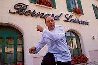 Bernard Loiseau outside his Hotel-Restaurant C(TM)te d'Or, Saulieu, Burgundy, 2000.© Owen Franken