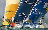 Three of the competing yachts approach the start of the in-port race, part of the Volvo Ocean Race.