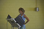 Jacqui Lear votes in a primary runoff election at the old National Guard Armory in Oxford, Miss. on Tuesday, August 23, 2011.