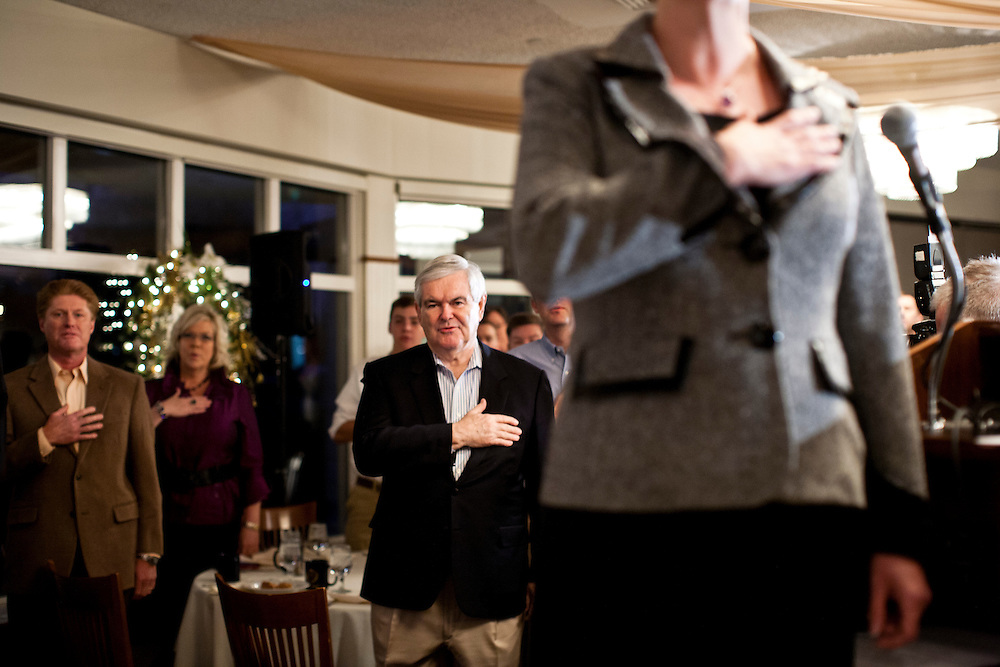 Republican presidential candidate Newt Gingrich says the pledge of allegiance at a campaign event at the Wakonda Club on Friday, December 30, 2011 in Des Moines, IA.