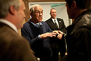 GOP presidential candidate Rep. Ron Paul speaks to supporters backstage at a campaign rally in the Grand Sierra Resort in Reno, Nev., February 2, 2012.