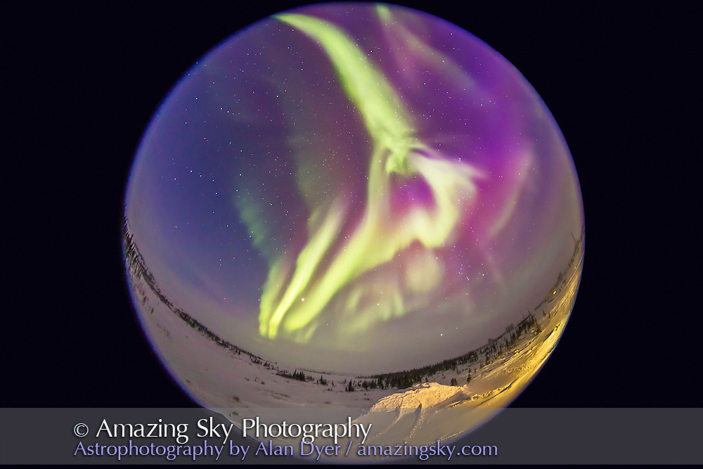 An all-sky aurora from Churchill, Manitoba, on Feb 17, 2015, in a frame from a 250-frame time-lapse movie. Taken from the Churchill Northern Studies Centre, using an 8mm Sigma  fish-eye lens on the Canon 6D for a 360° view of the sky, though with the camera titled about 25° to create an image suitable for projection in a tilted-dome digital planetarium. This a  15-second exposure at ISO 3200 and f/3.5. The temperature was about -30° C.