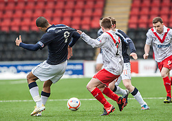 Falkirk's Lyle Taylor held by Airdrie United's Chris O'Neil..Airdrie United 0 v 1 Falkirk, 30/3/2013..©Michael Schofield..