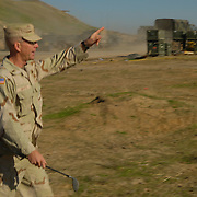 Dec 12th 2003...Quyarra, Mosul, Iraq.....Us Army Golf Course.....Lt Jesse White of the 101st Airbourne 'Task Masters' strides across the 6 hole golf course he built at a base 50kms south of Mosul in Northern Iraq. This course by location is perhaps the most hostile in the world and is reconed to be the first and only in Iraq.