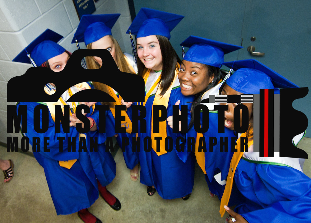 060211 Newark DE: St. Georges Tech HS students Kasey Cosden, Daria Fields, Taylor Clark, Emily Drinkwater (CQ) and Cheri Harmon pose for a photo while waiting in the hallway of The Bob Carpenter Center for the start of St.Georges Tech HS graduation ceremony Thursday, June 2, 2011 at The Bob Carpenter Center in Newark Delaware...Special to The News Journal/SAQUAN STIMPSON