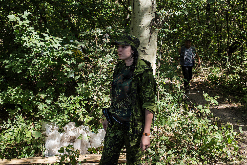 Marta, a pro-Russia rebel, at a camp by a checkpoint on the outskirts of the city on Monday, July 28, 2014 in Horlivka, Ukraine.