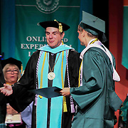Wilmington University candidate for bachelors of science Zachary Lee, RIGHT, receives his degree in general studies during Wilmington University commencement exercise Sunday, May 17, 2015, at Chase Center On The Riverfront in Wilmington Delaware.