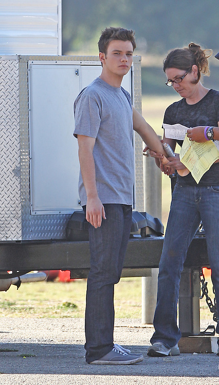 """July 12th 2011  Los Angeles, CA. ***EXCLUSIVE*** Chris Colfer from the TV show Glee makes his feature film acting debut on the set of """"Struck By Lightning"""", a coming of age indie film which was also written by Colfer. On the first day of filming Chris filmed scenes in a park in LA's San Fernando Valley. In one scene, Chris's character was struck by a lightning bolt which involved him getting dirty for the scene. Afterwards Chris was seen heading to his trailer to clean up and take a shower. Photo by Eric Ford / On Location News 818-613-3955 info@onlocationnews.com"""