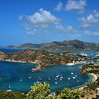 Elevated View of English and Falmouth Harbours in English Harbour, Antigua <br /> From the Battery platform, better known as The Lookout, at the Shirley Heights British fort is this magnificent view of the southernmost point of Antigua.  In the foreground is Fort Tyler at the end of the small peninsula that stretches into English Harbour.  On the right is Falmouth Harbour.  In the background are Sugar Loaf (1,042 feet) and Signal Hill (1,207 feet).