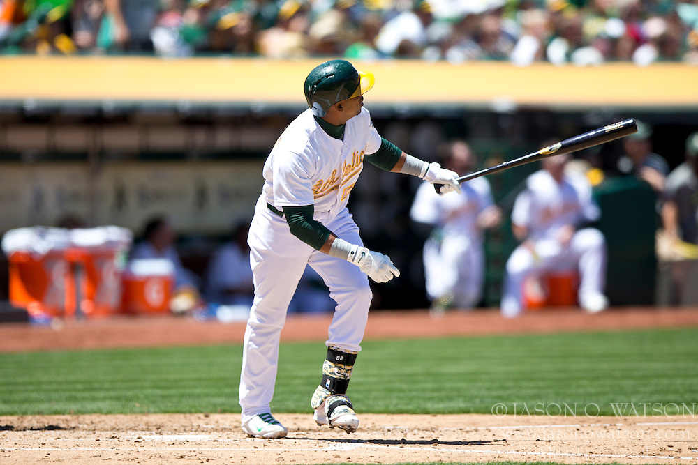 OAKLAND, CA - MAY 26:  Yoenis Cespedes #52 of the Oakland Athletics hits a home run off of Drew Smyly #33 of the Detroit Tigers (not pictured) during the third inning at O.co Coliseum on May 26, 2014 in Oakland, California. (Photo by Jason O. Watson/Getty Images) *** Local Caption *** Yoenis Cespedes