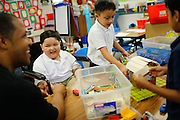 Noah Stout, 7, laughs with his father Anthony Stout as he plays with classmates classmates in Hilary Leday's second grade class for the first time since being diagnosed with Diffuse Intrinsic Pontine Glioma (DIPG), a rare and non-operable tumor located on the brain stem, at Sinnott Elementary School in Milpitas, California, on August 29, 2013. (Stan Olszewski/SOSKIphoto)