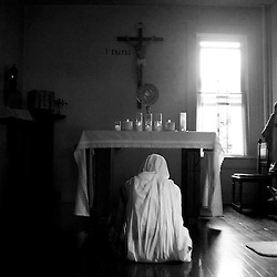 A nun prays in Anacostia.