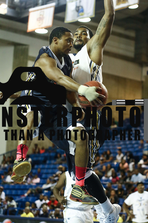 Actor and Rapper Romeo Miller son of well known rap mogul Master P, passes the ball as professional basketball player Marc Egerson defends in the 3rd quarter of the 2014 Duffy's Hope Celebrity Basketball Game Saturday, August 2, 2014, at The Bob Carpenter Sports Convocation Center, in Newark, DEL.    <br /> <br /> Proceeds will benefit The Non-Profit Organization Duffy's Hope Youth Programming.