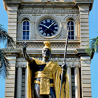 King Kamehameha Statue at Ali&rsquo;iōlani Hale in Honolulu, O&rsquo;ahu, Hawaii<br /> Fans of Hawaii Five-O will immediately recognize this bronze, gilded statue of King Kamehameha from the TV show&rsquo;s opening credits.  The Kingdom of Hawaii&rsquo;s first monarch stands in front of the Ali&rsquo;iōlani Hale building in Honolulu. The first sculpture was created by Thomas Gould but was lost in a shipwreck near the Falkland Islands during transport.  Although it was later recovered, the sculptor had already created this second version.  It was erected in 1883. The original is in the town of Kapā&rsquo;au on the Island of Hawaii.