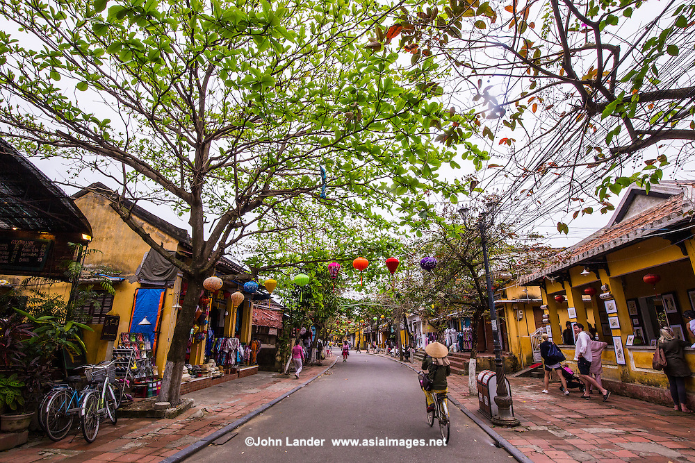 Hoi An Street Scene  - the combination of  Chinese, Vietnamese and French-colonial architectural gems has given Hoi An a unique look, that has earned it UNESCO World Heritage status for its intereting blend of architectural styles: 19th century stucco houses that show both influences from east and west add to the color of this eclectic mixture. Most of these beautiful buildings are well preserved and show an nteresting mix of architecture - all of which gives Hoi An UNESCO World Heritage Status.