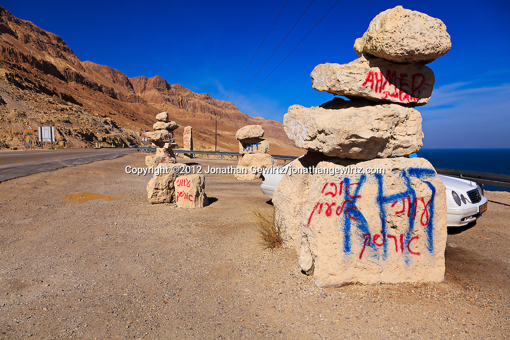 Graffiti covered boulders at a scenic overlook on Highway 90 on the Israeli side of the Dead Sea. WATERMARKS WILL NOT APPEAR ON PRINTS OR LICENSED IMAGES.