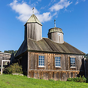 """Originally built in the 1820s, the restored chapel at Fort Ross was the first Russian Orthodox structure in North America outside of Alaska. Fort Ross State Historic Park preserves a former Russian colony (1812-1842) on the west coast of North America, in what is now Sonoma County, California, USA. Visit Fort Ross and dramatic coastal scenery 11 miles north of Jenner on California Highway One. For centuries before Europeans arrived, this site was called Metini and had been occupied by the Kashaya band of Pomo people who wove intricate baskets and harvested sea life, plants, acorns, deer, and small mammals. Sponsored by the Russian Empire, """"Settlement Ross"""" was multicultural, built mostly by Alaskan Alutiiq natives and occupied mostly by native Siberians, Alaskans, Hawaiians, Californians, and mixed Europeans. Initially, sea otter pelts funded Russian expansion, but by 1820, overhunting motivated the Russian-American Company to introduce moratoriums on hunting seals and otters, the first marine-mammal conservation laws in the Pacific. Russian voyages greatly expanded California's scientific knowledge. Renamed """"Ross"""" in 1812 in honor of Imperial Russian (Rossiia), Fortress Ross was intended to grow wheat and other crops to feed Russians living in Alaska, but after 30 years was found to be unsustainable. Fort Ross was sold to John Sutter in 1841, and his trusted assistant John Bidwell transported its hardware and animals to Sutter's Fort in the Sacramento Valley. Fort Ross is a landmark in European imperialism, which brought Spanish expanding west across the Atlantic Ocean and Russians spreading east across Siberia and the Pacific Ocean. In the early 1800s, Russians coming from the north met Spanish coming from the south along the Pacific Coast of California, followed by the USA arriving from the east in 1846 for the Mexican-American War. Today, Fort Ross is a California Historical Landmark and a National Historic Landmark. See www.FortRoss.org on the internet."""