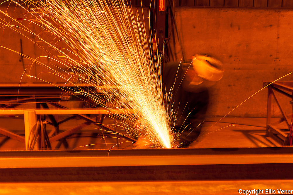 iron worker using a grinding wheel on steel