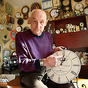 """A man with more than 650 clocks in his home will spend TWO weeks resetting them when the clocks go back tomorrow (Sun Oct 26)...Keith Giddings,(PICTURED)  from Berkhamsted,Hertfordshire,who is known as Mr Tick Tock, has a mammoth task ahead of him when the clocks move backwards from British Summer Time to Greenwich Mean Time at 1am...The 66-year-old has been collecting clocks for 35 years and now has hundreds squeezed onto every wall of his two-bedroom home...""""It takes me at least two weeks to change all the clocks in the house"""", he said...""""I do it a wall at a time but my wife gets confused as for a couple of weeks they all show different times...""""You should never wind a clock backwards so it's a long process, but for me it's a real labour of love.""""..Keith first started collecting clocks after moving into his home with wife Majorie, 65, shortly after they were married...The couple bought a wooden wall clock and Keith liked it so much he kept buying more and more clocks...They now have more than 340 in the lounge, 25 in their bedroom, 40 in the kitchen, 12 in the downstairs loo and even a few in the garden...Keith said: """"I've got clocks of all shapes and sizes. I've got a bendy clock, I've got one with cogs that move in different directions, one that only has 10 numbers and an Irish clock that goes backwards...""""I've even got a guitar-shaped clock and a cushion clock...""""I don't know why I like clocks so much, but I love every single one of them...""""I get given clocks for every birthday and Christmas and I'll never stop collecting. My wife thinks I'm crazy but just accepts my hobby now.""""..Keith, whose house is called Clocks and who has a budgie called Tick Tock, said visitors find the house rather noisy... SEE COPY CATCHLINE CLOCKS TAKE 2 WEEKS TO GO  BACK..."""