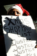 A marcher participates in a  silent march down Fifth Avenue  ''to shop for justice,'' in the police shooting incident that killed Sean Bell and wounded two of his friends on his wedding day in New York, December 16, 2006. .Photo by Keith Bedford<br />