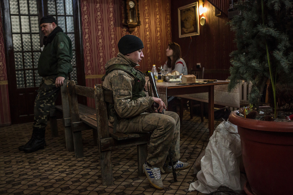 Rebel fighters relax inside a house in which they live behind a front-line position on January 31, 2015 in Gorlovka, Ukraine. Fighting in Ukraine has intensified over the last week, with rebels declaring the end of a September ceasefire.